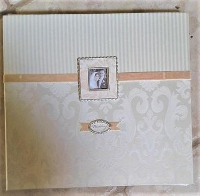 Weddign album with velvet border.jpg
